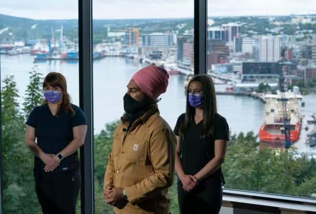 New Democratic Party Leader Jagmeet Singh speaks during a campaign stop in St. John's, N.L., on Saturday, Sept. 4, 2021. Speaking alongside two dental hygienists, Singh pledged to bring in a federal program to help Canadians who earn less than $90,000 per year pay for dental expenses. (Adrian Wyld/The Canadian Press - image credit)
