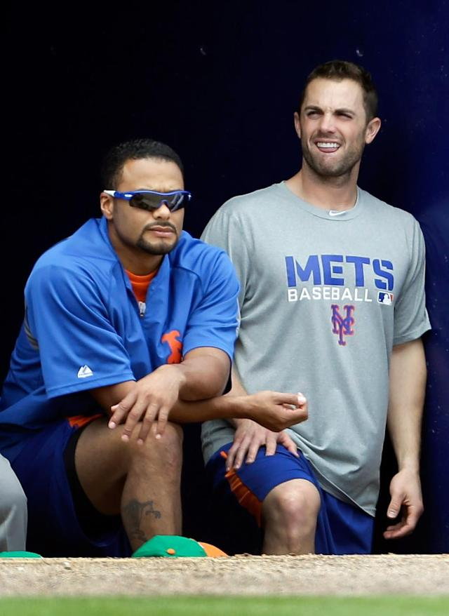 FILE - In this March 17, 2013, file photo, New York Mets pitcher Johan Santana, left, and third baseman David Wright watch from the dugout during a spring training baseball game against the Atlanta Braves in Port St. Lucie, Fla. The Mets have declined a $25 million option on the injured pitcher on Friday, Nov. 1, 2013, and will pay the left-hander a $5.5 million buyout. Santana will be 35 next season and becomes a free agent. (AP Photo/Jeff Roberson, File)