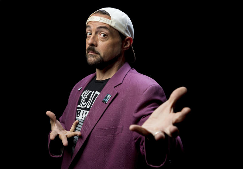 """This Sept. 25, 2019 photo shows Kevin Smith posing during an interview in Los Angeles to promote his film """"Jay and Silent Bob Reboot."""" (Photo by Willy Sanjuan/Invision/AP)"""