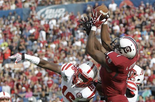 South Carolina wide receiver Alshon Jeffery, right, grabs a pass over Nebraska cornerback Stanley Jean-Baptiste (16) for a 51-yard touchdown as time expires in the first half of the Capital One Bowl NCAA college football game, Monday, Jan. 2, 2012, in Orlando, Fla. (AP Photo/John Raoux)