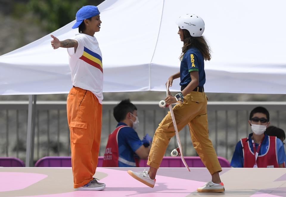 FILE PHOTO: Margielyn Didal gives Rayssa Leal (Brazil) a hug after during the women's skateboarding street final during the Tokyo 2020 Olympics at the Ariake Urban Sports Park on July 26, 2021. (Source: REUTERS/Toby Melville)