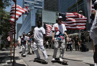 FILE - Members of the first U.S. Olympic skateboarding team arrive on their boards for a news conference in downtown Los Angeles in this Monday, June 21, 2021, file photo. Three-quarters of the 613-person U.S. Olympic team that was released Tuesday, July 13, 2021, competed in the American collegiate system — the most up-to-date number to illustrate the country's dependence on NCAA and other college programs to bring home medals. (AP Photo/Richard Vogel, File)