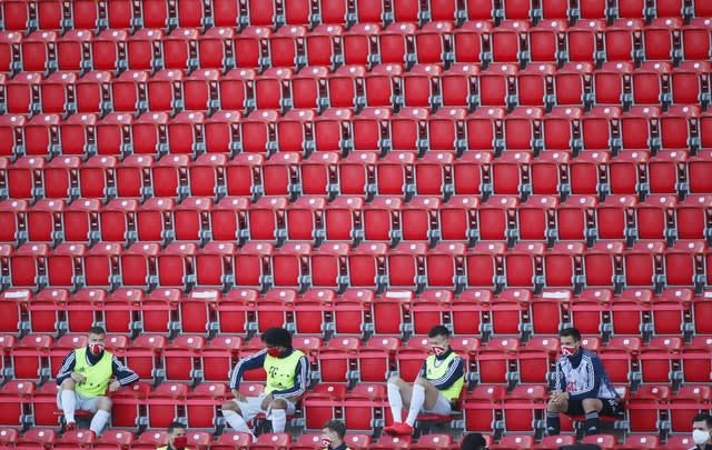 Bayern Munich's substitutes sit spread out in the stands to maintain social distancing (Hannibal Hanschke/PA)