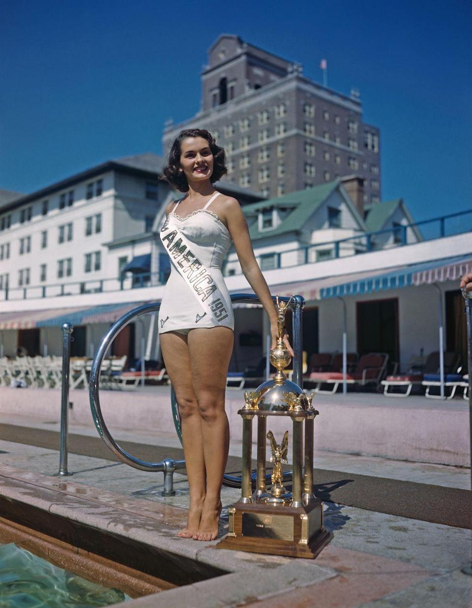 <p>Yolande Betbeze of Alabama looked perfect by the pool in a white, lace-trimmed swimsuit. She's hard to miss with that shiny trophy and matching sash.</p>