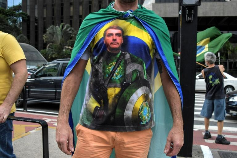 A supporter of Brazilian President Jair Bolsonaro wears a T-shirt depicting him during a protest against quarantine and social distancing measures in Sao Paulo, Brazil, on May 1, 2020 (AFP Photo/NELSON ALMEIDA)
