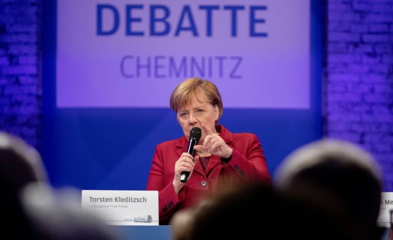 Merkel spent half a day in the former communist city of Chemnitz meeting residents, but tensions were clear with about one hundred far-right protesters marching and the city mayor criticizing her