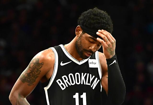 "Kyrie Irving's well-documented ""mood swings"" are reportedly causing the Nets to feel ""queasy."" (Photo by Emilee Chinn/Getty Images)"