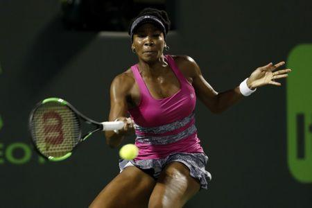 Mar 30, 2017; Miami, FL, USA; Venus Williams of the United States hits a forehand against Johanna Konta of Great Britain (not pictured) in a women's singles semi-final during the 2017 Miami Open at Crandon Park Tennis Center Mandatory Credit: Geoff Burke-USA TODAY Sports