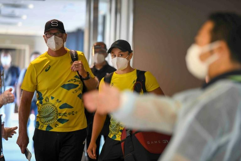 World number one tennis player Ashleigh Barty (C) was a high-profile arrival on Monday
