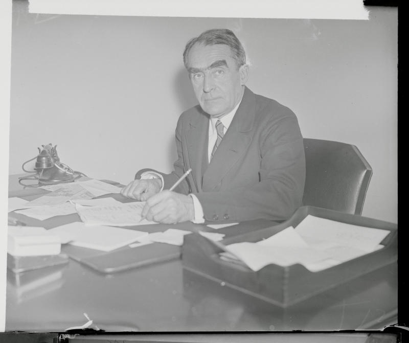 Admiral Cary T. Grayson, physician to the late President Wilson, at his desk in Washington, DC, on January 5, 1933. (Getty Images)