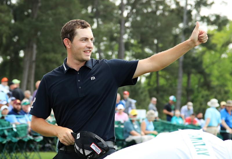 Patrick Cantlay acknowledges patrons after finishing on the 18th green during the third round of the 2019 Masters.