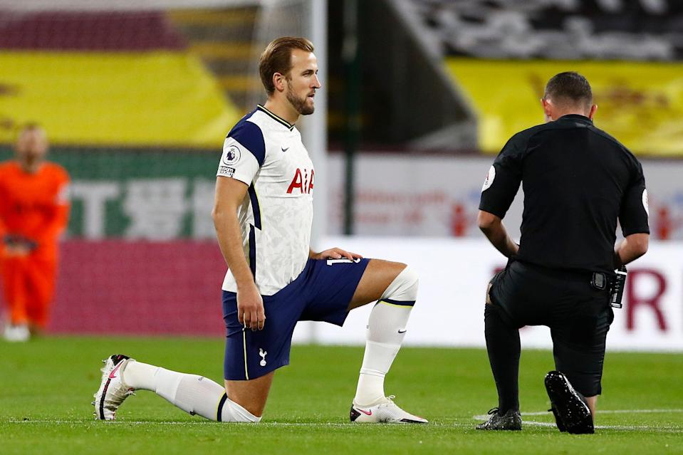 Harry Kane believes it is important for players to continue to take a knee before Premier League matches (EPA)