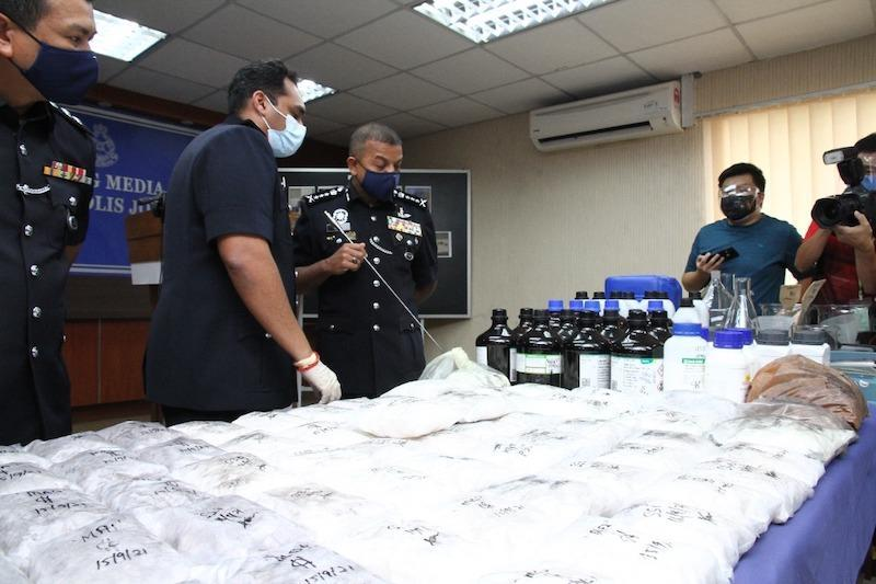 Johor police chief Datuk Ayob Khan Mydin Pitchay with the drugs seized after a series of raids in Johor Baru and Iskandar Puteri districts yesterday, September 17, 2021 — Picture by Ben Tan
