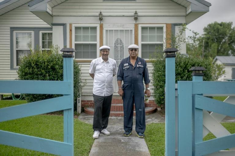 Angelo Bernard (R) in front of his home with his brother Byron in Reserve