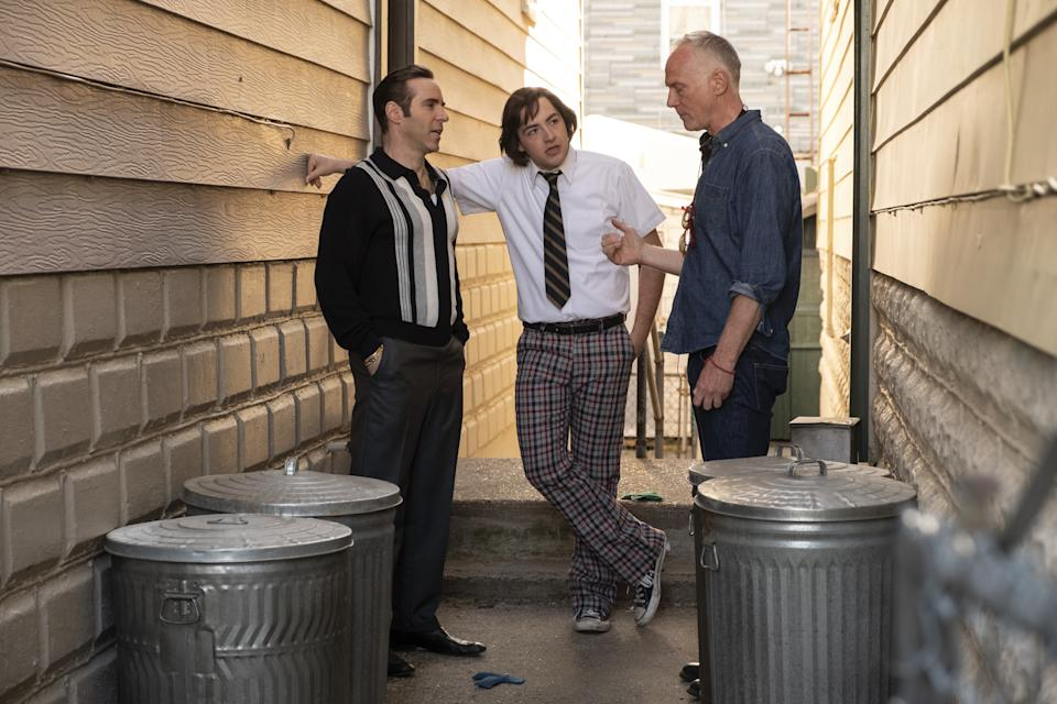 """Alessandro Nivola, Michael Gandolfini and director Alan Taylor on the set of New Line Cinema and Home Box Office's mob drama """"The Many Saints of Newark,"""" a Warner Bros. Pictures release. (Barry Wetcher/Warner Bros. Entertainment Inc.)"""