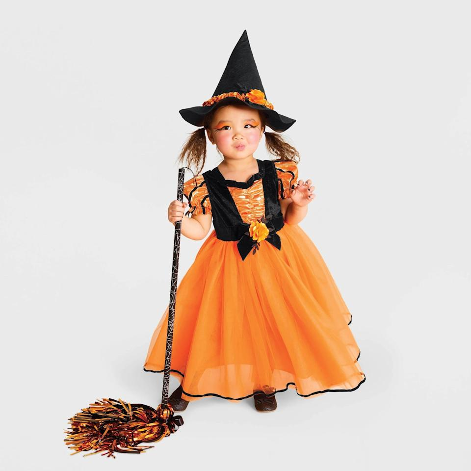 "<p>I think we can agree, this <a href=""https://www.popsugar.com/buy/Toddler-Girls-Fancy-Witch-Halloween-Costume-496593?p_name=Toddler%20Girls%27%20Fancy%20Witch%20Halloween%20Costume&retailer=target.com&pid=496593&price=25&evar1=moms%3Aus&evar9=46700813&evar98=https%3A%2F%2Fwww.popsugar.com%2Ffamily%2Fphoto-gallery%2F46700813%2Fimage%2F46701395%2FToddler-Girls-Fancy-Witch-Halloween-Costume&list1=shopping%2Ctarget%2Challoween%2Ctoddlers%2Challoween%20costumes%2Challoween%20for%20kids%2Ckid%20halloween%20costumes%2Challoween%20costumes%202019&prop13=api&pdata=1"" rel=""nofollow"" data-shoppable-link=""1"" target=""_blank"" class=""ga-track"" data-ga-category=""Related"" data-ga-label=""https://www.target.com/p/toddler-girls-fancy-witch-halloween-costume-orange-hyde-eek-boutique/-/A-54497854?preselect=75667889#lnk=sametab"" data-ga-action=""In-Line Links"">Toddler Girls' Fancy Witch Halloween Costume </a> ($25) is <em>wicked</em> cute. </p>"