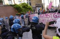 Italian Policemen in riot gears clash with demonstrators during a protest against the G20 Economy and Finance ministers and Central bank governors' meeting in Venice, Italy, Saturday, July 10, 2021. (AP Photo/Luca Bruno)