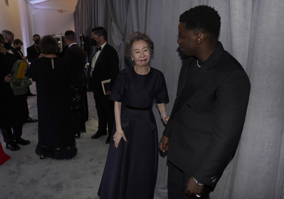 """Yuh-Jung Youn, left, winner of the award for best actress in a supporting role for """"Minari,"""" and Daniel Kaluuya, winner of the award for best actor in a supporting role for """"Judas and the Black Messiah,"""" talk outside the press room at the Oscars on Sunday, April 25, 2021, at Union Station in Los Angeles. (AP Photo/Chris Pizzello, Pool)"""