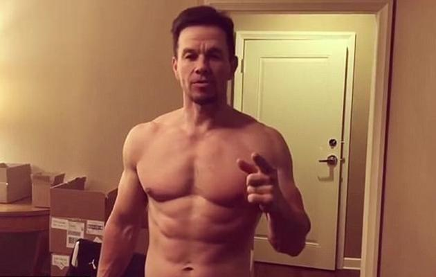 Actor Mark Wahlberg shows off his ripped abs and bulging biceps in social media video. Source: Instagram