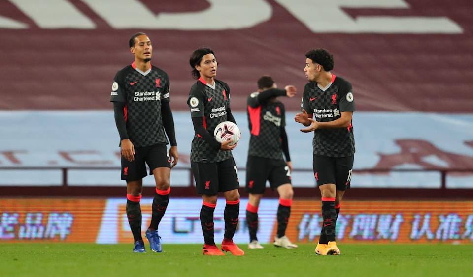 BIRMINGHAM, ENGLAND - OCTOBER 04: Virgil van Dijk of Liverpool , Takumi Minamino of Liverpool  react after Aston Villas 6th goal during the Premier League match between Aston Villa and Liverpool at Villa Park on October 04, 2020 in Birmingham, England. Sporting stadiums around the UK remain under strict restrictions due to the Coronavirus Pandemic as Government social distancing laws prohibit fans inside venues resulting in games being played behind closed doors. (Photo by Catherine Ivill/Getty Images)