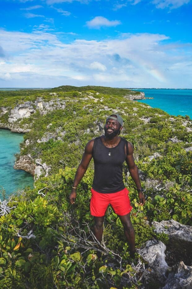 Mario Rigby, a Turks-and-Caicos-born explorer pictured above on the island of Providenciales, will run, hike, cycle, paddle and swim the 225-kilometre distance this April. (Submitted by Mario Rigby - image credit)