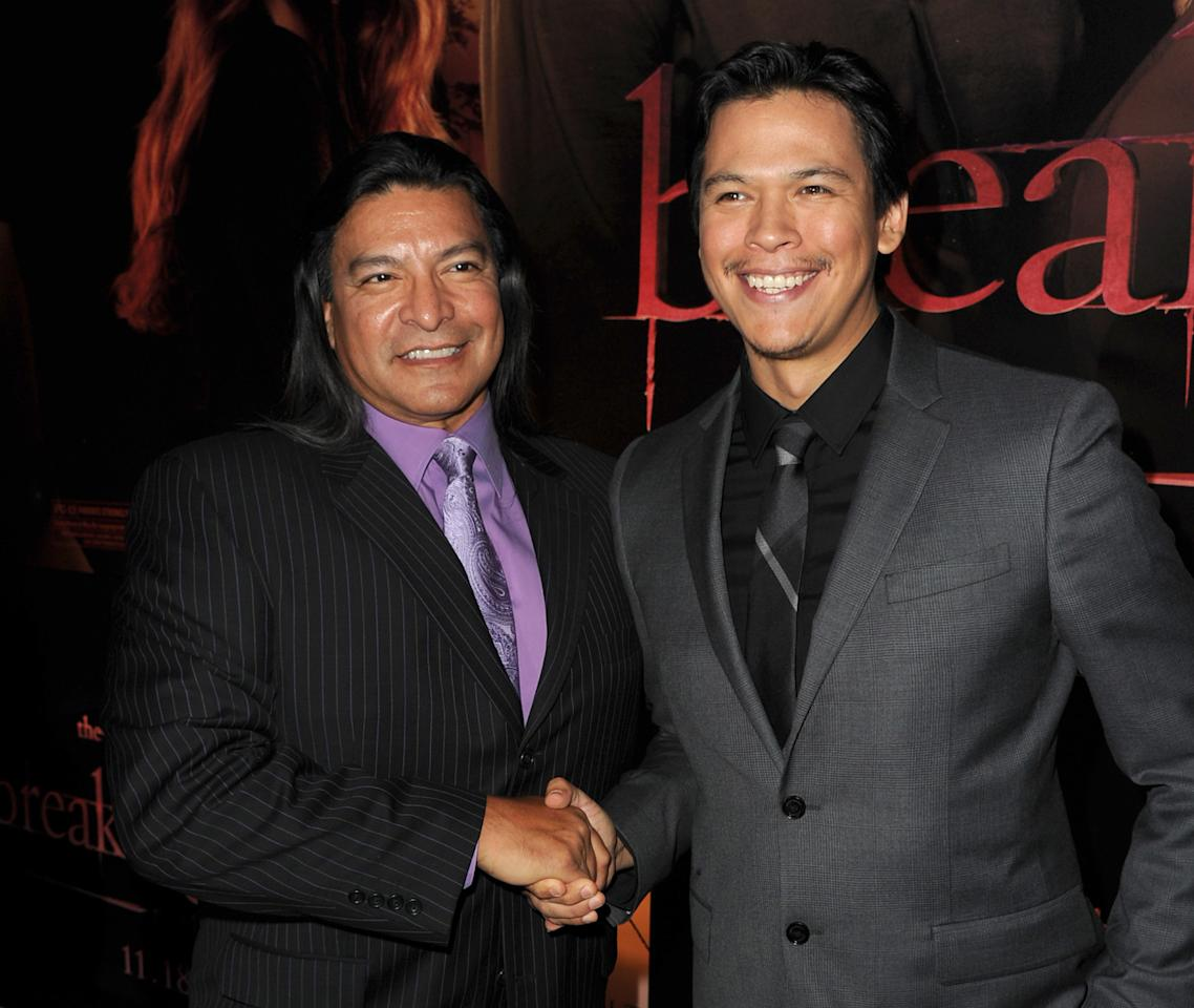 "LOS ANGELES, CA - NOVEMBER 14:  Actors Gil Birmingham (L) and Chaske Spencer arrive at the premiere of Summit Entertainment's ""The Twilight Saga: Breaking Dawn - Part 1"" at Nokia Theatre L.A. Live on November 14, 2011 in Los Angeles, California.  (Photo by Kevin Winter/Getty Images)"