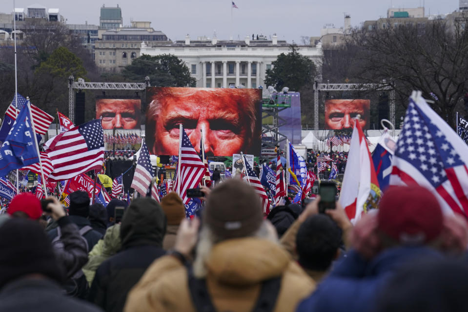 FILE - In this Jan. 6, 2021 file photo, Trump supporters participate in a rally in Washington. Months after Donald Trump's supporters besieged the Capitol, the ex-president and his supporters are revising their account of that day. (AP Photo/John Minchillo, File)