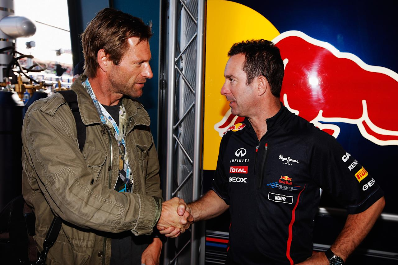 MELBOURNE, AUSTRALIA - MARCH 18:  Actor Aaron Eckhardt meets Red Bull Racing Chief Mechanic Kenny Handkammer before the Australian Formula One Grand Prix at the Albert Park circuit on March 18, 2012 in Melbourne, Australia.  (Photo by Mark Thompson/Getty Images)