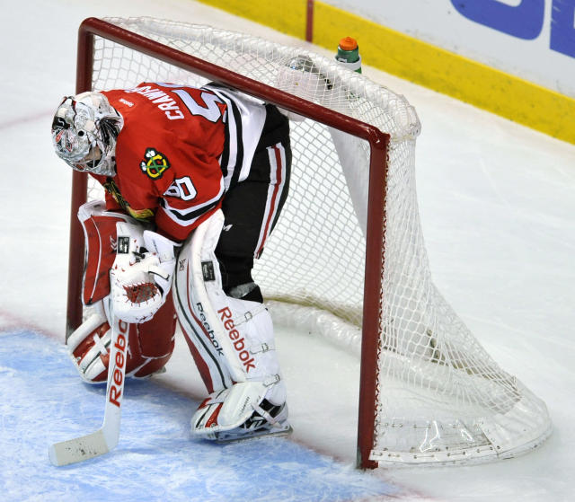 Chicago Blackhawks goalie Corey Crawford reacts after giving up a goal to Colorado Avalanche's Brad Stuart during the third period of an NHL hockey game in Chicago, Friday, Feb. 20, 2015. Colorado won 4-1. (AP Photo/Paul Beaty)