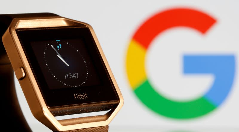 FILE PHOTO: Fitbit Blaze watch is seen in front of a displayed Google logo in this illustration