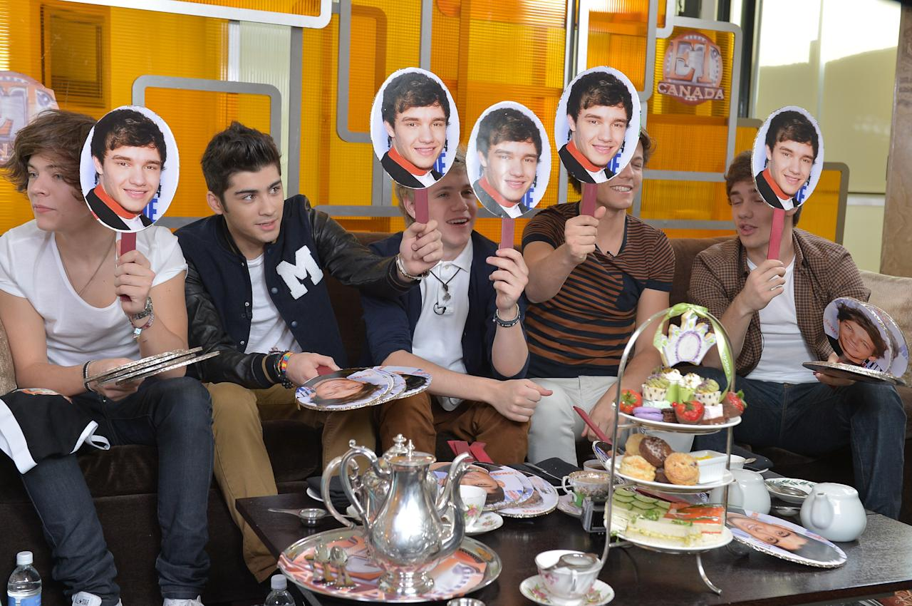 TORONTO, ON - MARCH 26:  (L-R) Harry Styles, Zayn Mali, Niall Horan, Louis Tomlinson and Liam Payne from One Direction Visit ET Canada Studios on March 26, 2012 in Toronto, Canada.  (Photo by George Pimentel/Getty Images)