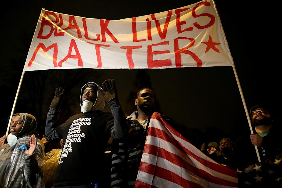 Demonstrators march through the streets to protest the shooting death of 18-year-old Michael Brown on November 23, 2014 in St. Louis, Missouri (AFP Photo/Justin Sullivan)