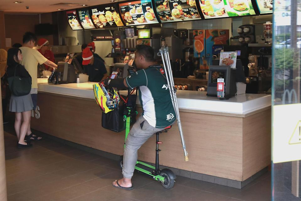 Saire waits for a food order at a McDonald's outlet at The Clementi Mall on Thursday (14 December). (PHOTO: Dhany Osman / Yahoo News Singapore)