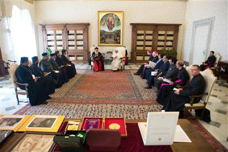 Pope Francis listens to a speech during a private audience with Baselios Mar Thoma Paulose II, Catholicos of the East & Malankara Metropolitan of the Malankara Orthodox Syrian Church, at the Vatican