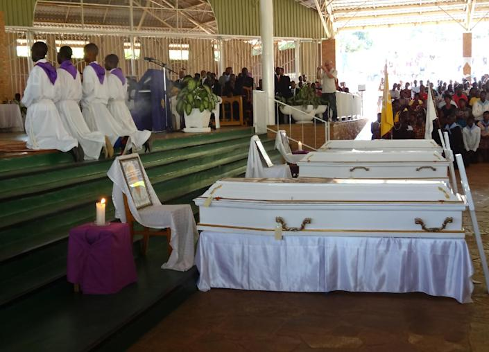 The coffins of three Italian nuns are seen at their funeral at The Shrine of Mont Sion Gikungu in Bujumbura on September 10, 2014 (AFP Photo/Esdras Ndikumana)