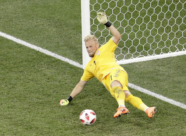 Denmark goalkeeper Kasper Schmeichel makes a save during a penalty shoot out after extra time during the round of 16 match between Croatia and Denmark at the 2018 soccer World Cup in the Nizhny Novgorod Stadium, in Nizhny Novgorod , Russia, Sunday, July 1, 2018. (AP Photo/Dmitri Lovetsky)