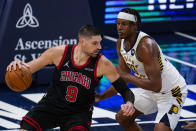Chicago Bulls center Nikola Vucevic (9) drives on Indiana Pacers center Myles Turner (33) during the first half of an NBA basketball game in Indianapolis, Tuesday, April 6, 2021. (AP Photo/Michael Conroy)
