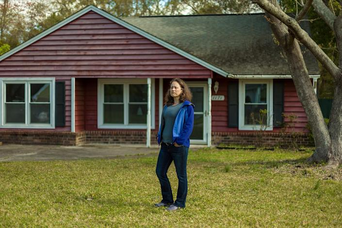 Ana Zimmerman stands in front her former home. that she owned the home between 2005 and 2019.