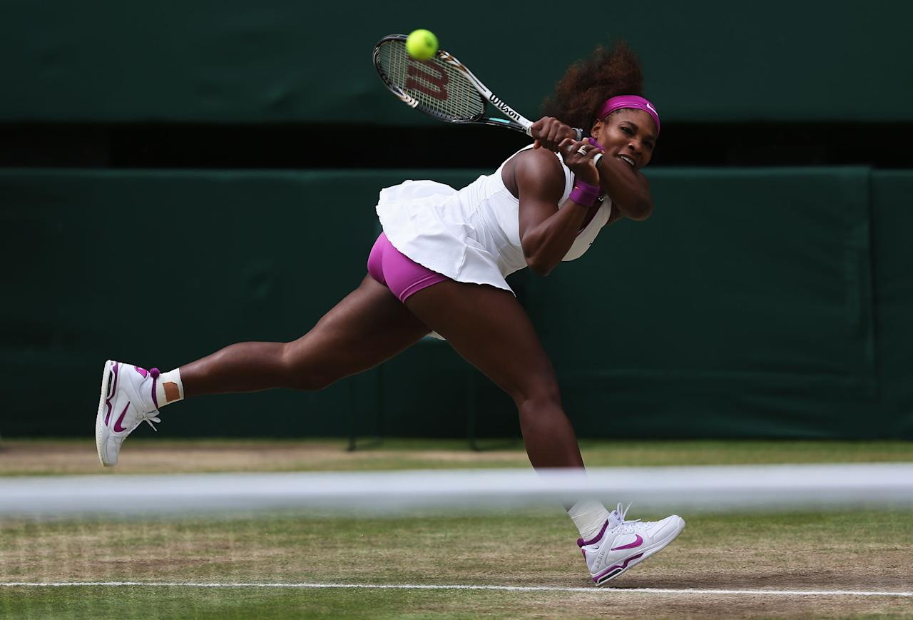 LONDON, ENGLAND - JULY 07:  Serena Williams of the USA hits a backhand return during her Ladies? Singles final match against Agnieszka Radwanska of Poland on day twelve of the Wimbledon Lawn Tennis Championships at the All England Lawn Tennis and Croquet Club on July 7, 2012 in London, England.  (Photo by Clive Rose/Getty Images)