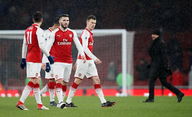 """Soccer Football - Premier League - Arsenal vs Manchester City - Emirates Stadium, London, Britain - March 1, 2018 Arsenal's Sead Kolasinac and Laurent Koscielny look dejected after the match REUTERS/David Klein EDITORIAL USE ONLY. No use with unauthorized audio, video, data, fixture lists, club/league logos or """"live"""" services. Online in-match use limited to 75 images, no video emulation. No use in betting, games or single club/league/player publications. Please contact your account representative for further details."""