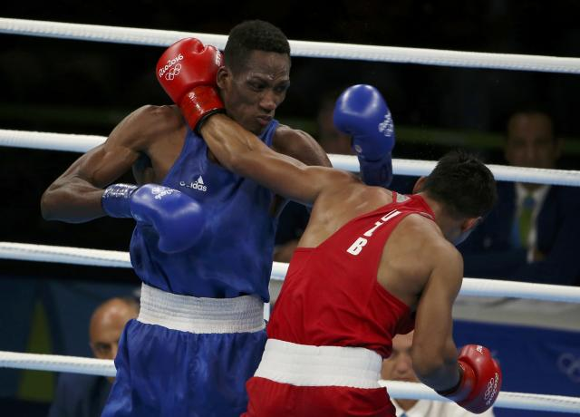 2016 Rio Olympics - Boxing - Final - Men's Light Welter (64kg) Final Bout 272 - Riocentro - Pavilion 6 - Rio de Janeiro, Brazil - 21/08/2016. Fazliddin Gaibnazarov (UZB) of Uzbekistan and Collazo Sotomayor (AZE) of Azerbaijan compete. REUTERS/Matthew Childs FOR EDITORIAL USE ONLY. NOT FOR SALE FOR MARKETING OR ADVERTISING CAMPAIGNS.