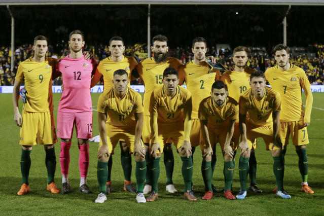 FILE - In this Tuesday, March 27, 2018 file photo, Australia's, back row from left, Tomi Juric, Bradley Jones, Tom Rogic, Mile Jedinak, Milos Degenek, Josh Risdon, Mathew Leckie and, front left to right, Andrew Nabbout, Massimo Luongo, Aziz Behich, Mark Milligan, during the national anthems before a friendly soccer match between Colombia and Australia in London, Tuesday, March 27, 2018. (AP Photo/Tim Ireland, File)