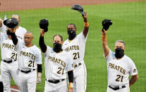 Pittsburgh Pirates players and coaches lift their caps at the end of the national anthem on Roberto Clemente Day before a baseball game against the Chicago White Sox, Wednesday, Sept. 9, 2020, in Pittsburgh. (Matt Freed/Pittsburgh Post-Gazette via AP)