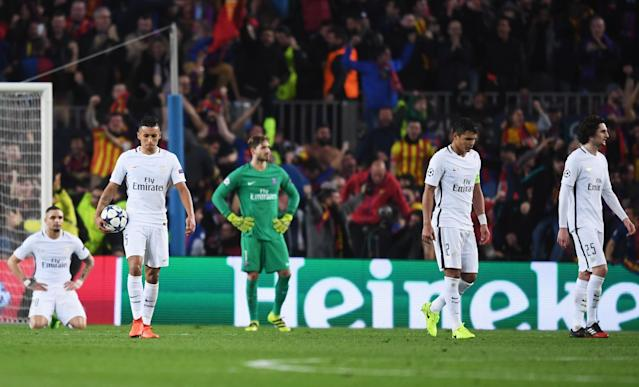 <p>PSG players look dejected as Sergi Roberto of Barcelona scores their sixth goal during the UEFA Champions League Round of 16 second leg match between FC Barcelona and Paris Saint-Germain at Camp Nou on March 8, 2017 in Barcelona, Spain. (Photo by Michael Regan/Getty Images) </p>