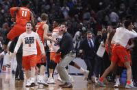 Members of the Syracuse team celebrate a 55-53 win over Michigan State in a second-round game in the NCAA men's college basketball tournament Sunday, March 18, 2018, in Detroit. (AP Photo/Carlos Osorio)