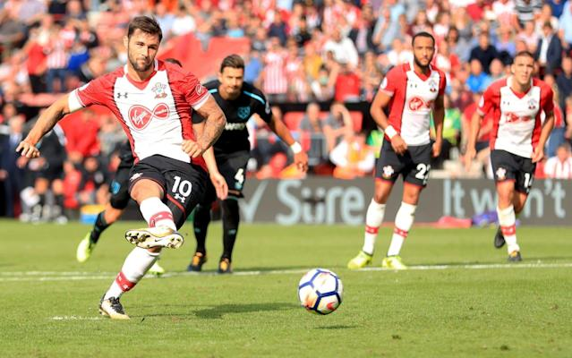 Charlie Austin scores from the spot in the 93rd minute at St Mary's - PA