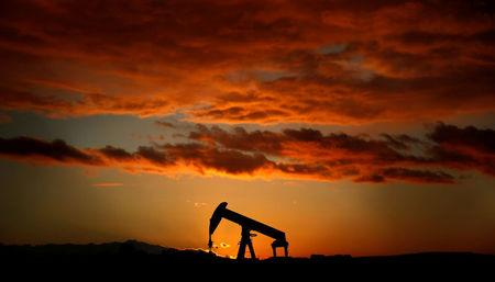 FILE PHOTO:An oil pump jack at sunset near Strasbourg, France