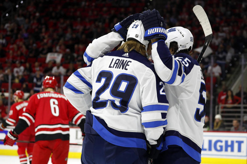The Winnipeg Jets celebrate a goal by Patrik Laine (29) against the Carolina Hurricanes during the first period of an NHL hockey game in Raleigh, N.C., Tuesday, Jan. 21, 2020. (AP Photo/Karl B DeBlaker)