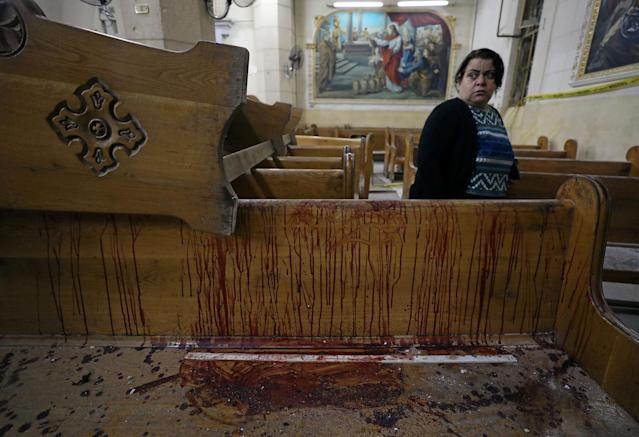 <p>APR. 9, 2017 – A woman stands near a pew covered in blood inside a Coptic church that was bombed in Tanta, Egypt. Islamic State claimed responsibility for the attacks, which more than 44 were killed and injured more than 100 people and occurred a week before Coptic Easte.r (Photo: Mohamed Abd El Ghany/Reuters) </p>