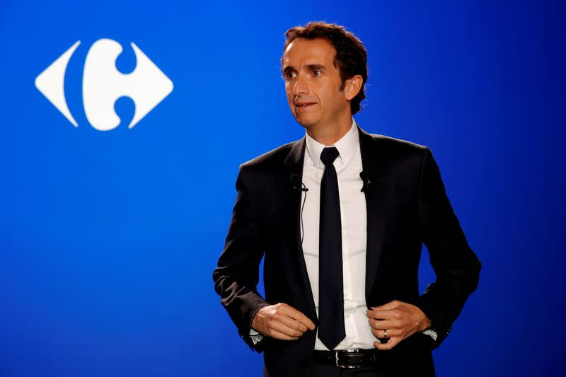 FILE PHOTO: Alexandre Bompard, CEO of French retailer Carrefour, poses before a news conference in La Defense near Paris